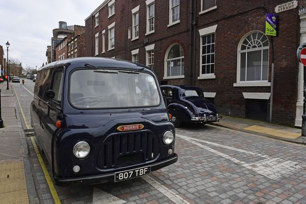 City centre street transformed into 1960s London with classic cars for ITV filming